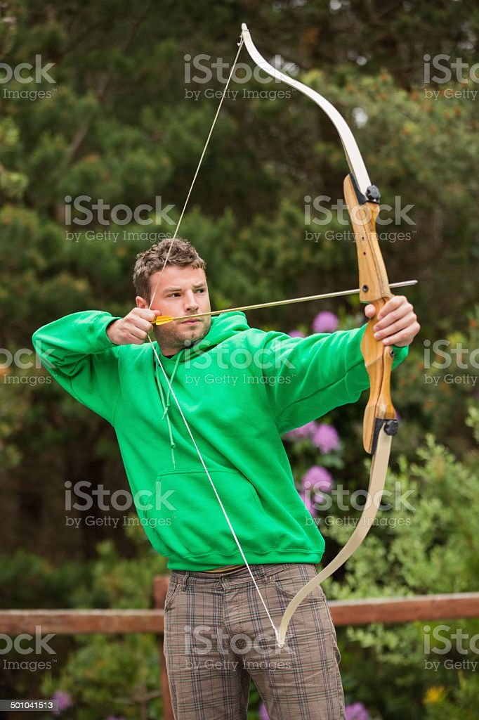 Focused man practicing archery stock photo