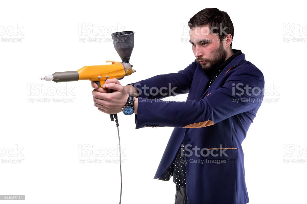 Focused man with powder gun stock photo