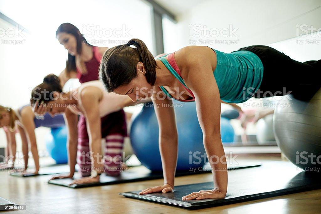 Focused on her pilates technique stock photo