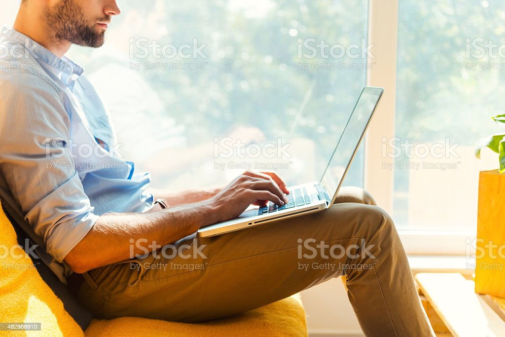 Focused on his work. stock photo