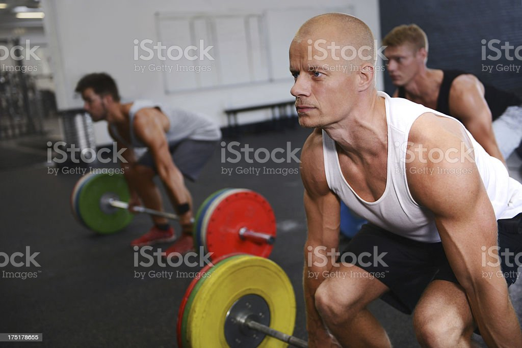 Focused on lifting this huge weight royalty-free stock photo
