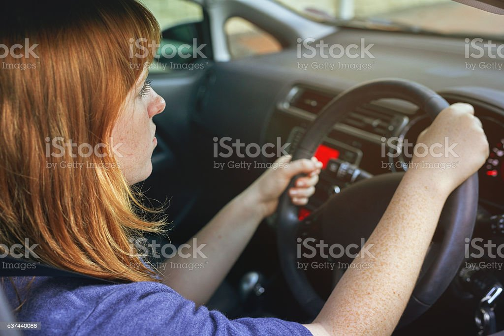 Focused on the road ahead of her stock photo