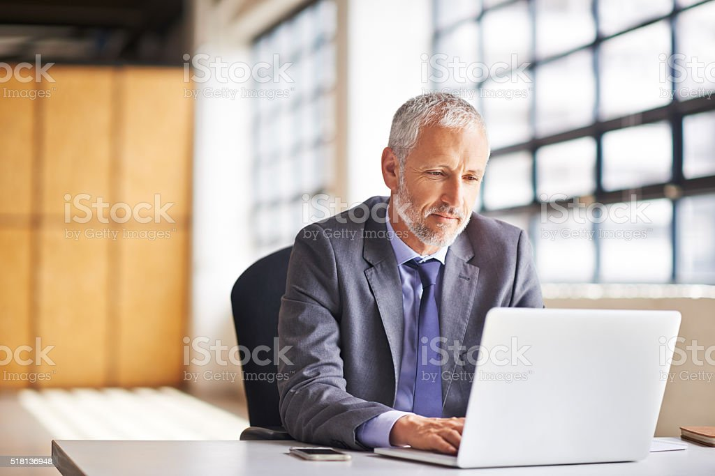 Focused on the task in front of him stock photo
