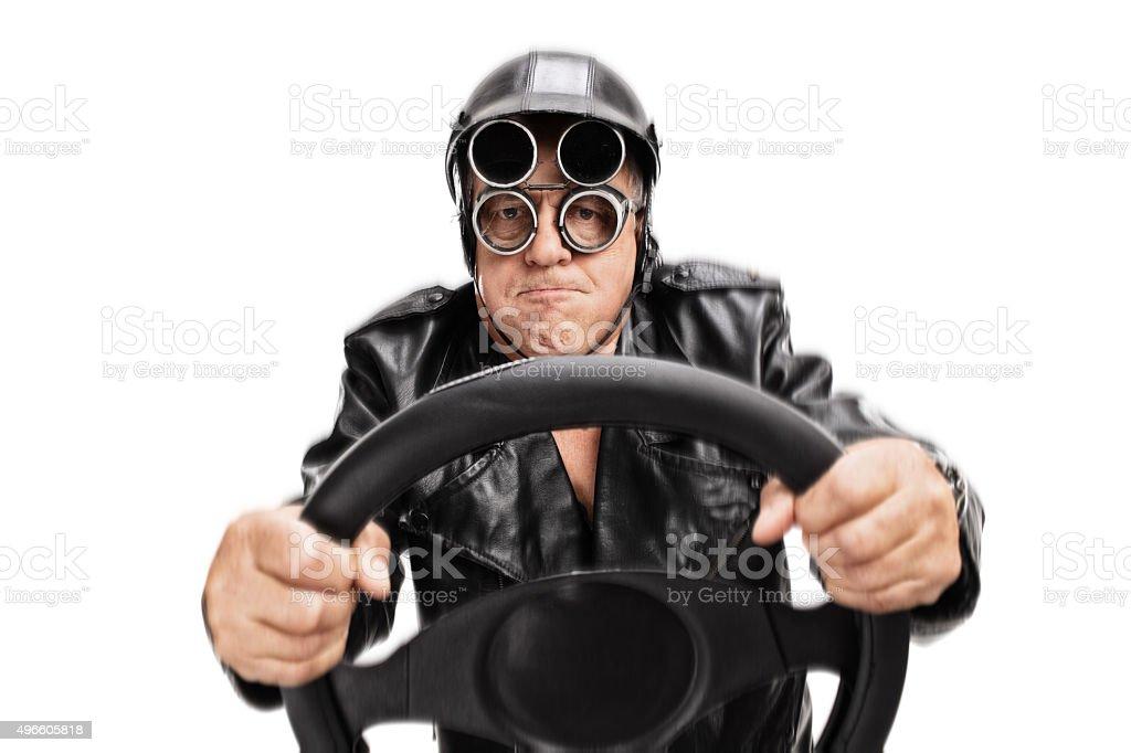 Focused senior driver holding a steering wheel stock photo