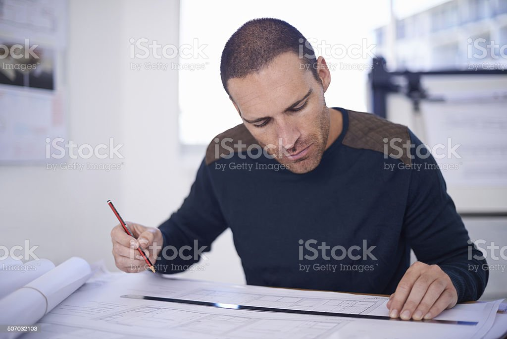 Focused to ensure perfection royalty-free stock photo