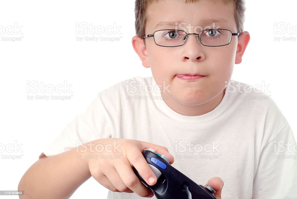 Focused Young Boy with Video Game Controller in his Hands royalty-free stock photo