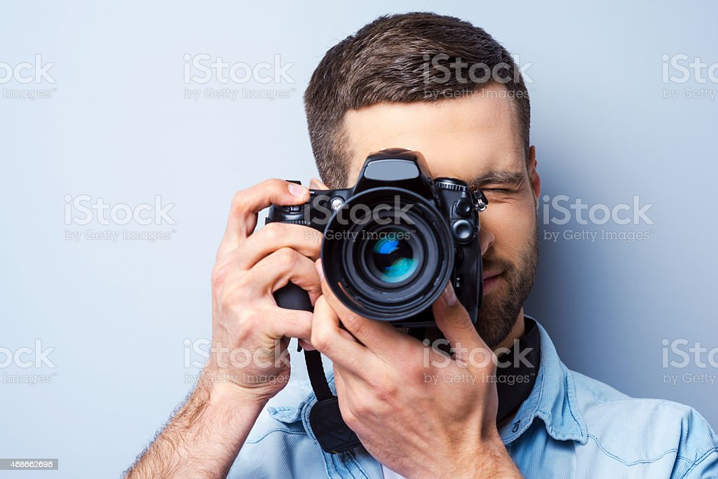 Focusing at you. stock photo