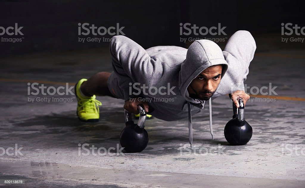 Focussed on his workout stock photo