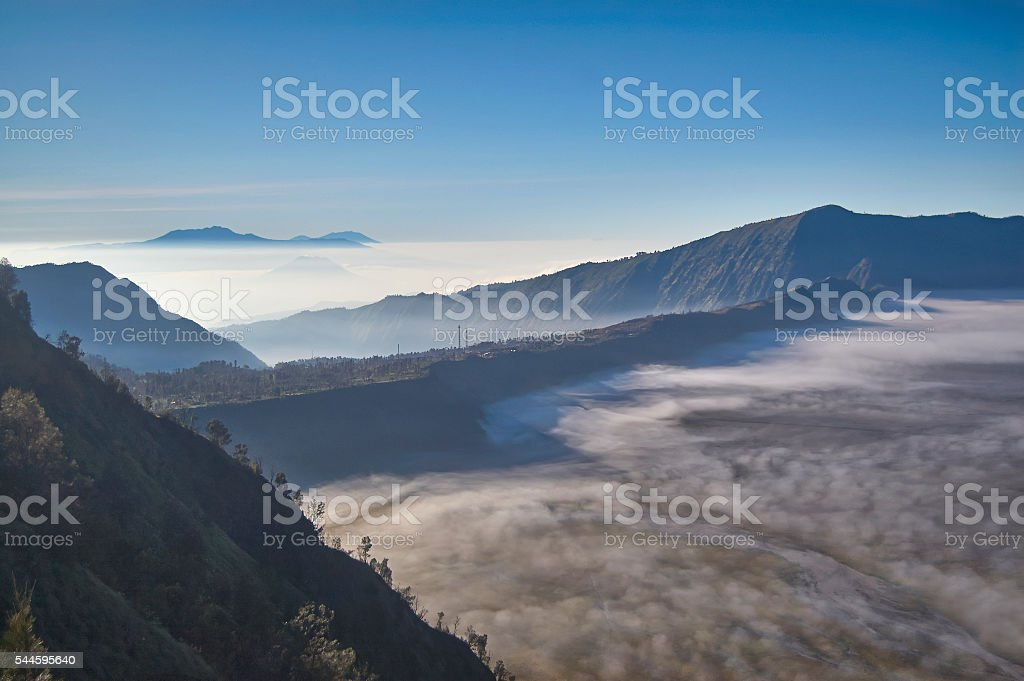 Fog and cold mist of volcano Bromo in Indonesia stock photo