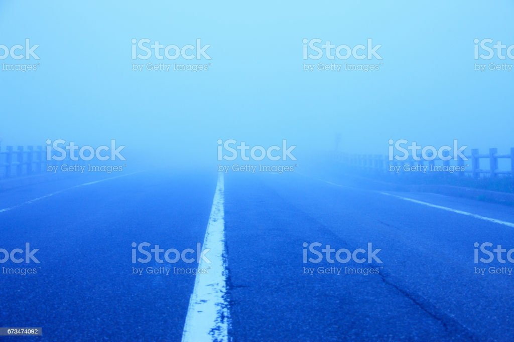Fog and road stock photo