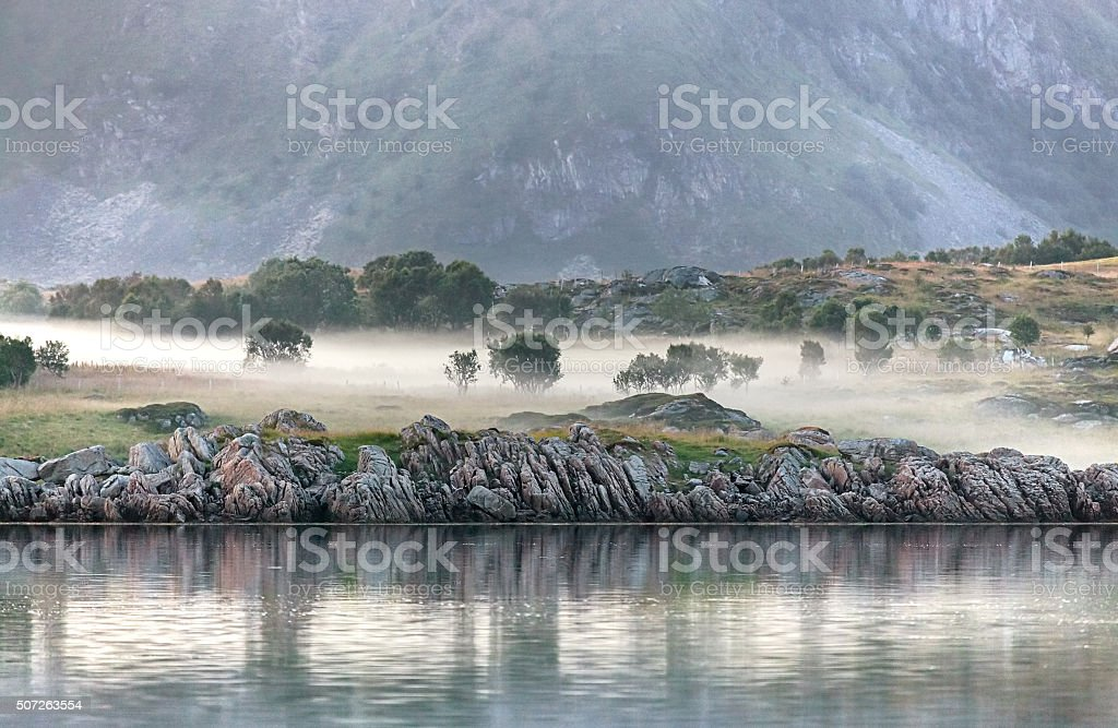 Fog at midnight in Gimsoy, Lofoten Islands, Norway stock photo