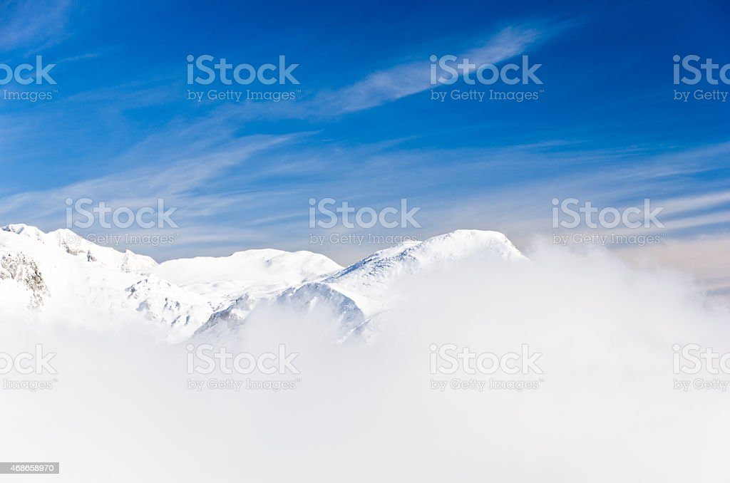 Fog at top of the mountain on winter sunny morning stock photo
