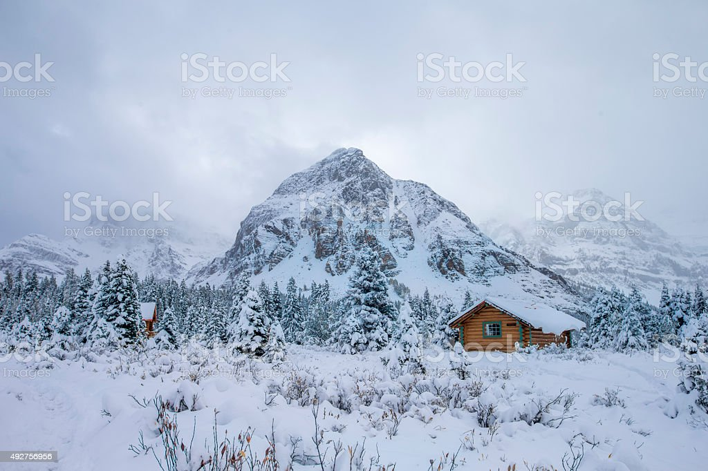 Fog, Cabin and Snow at Mount Assiniboine Provincial Park, Canada. stock photo