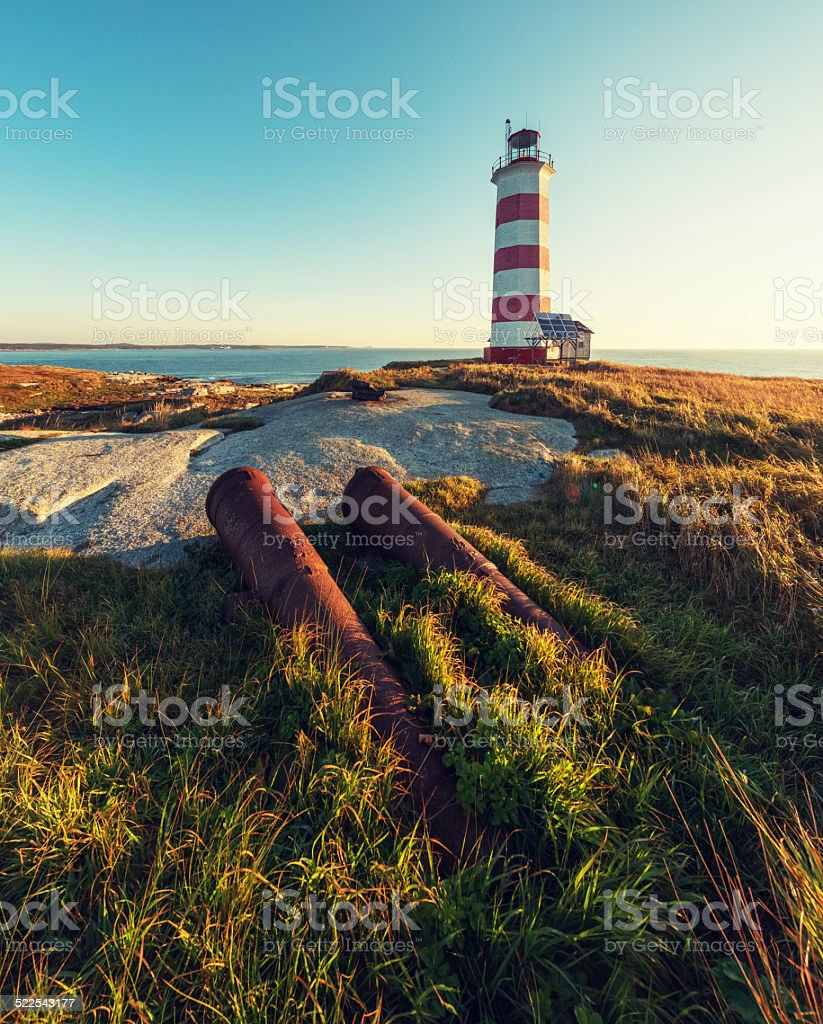 Fog Canons with Lighthouse stock photo