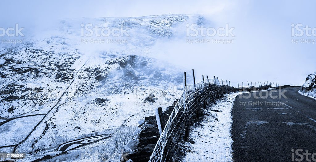 Fog Coming Over The Mountains On Kirkstone Pass Country Road. stock photo