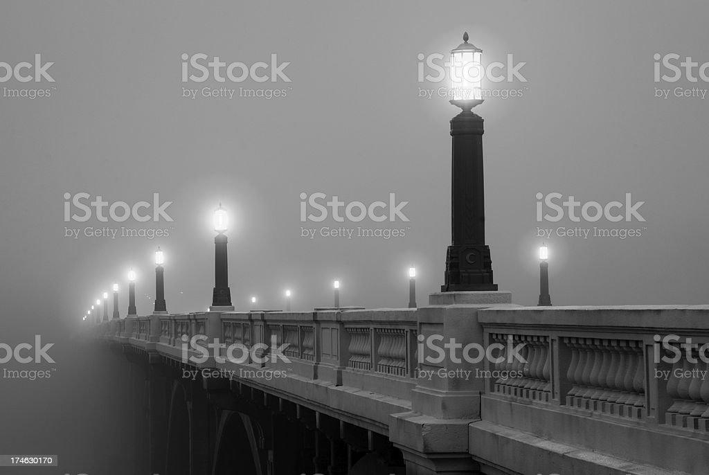 Fog covered bridge stock photo