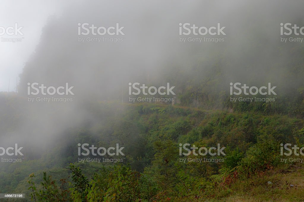 Fog covering the slopes around Zunil, Guatemala stock photo