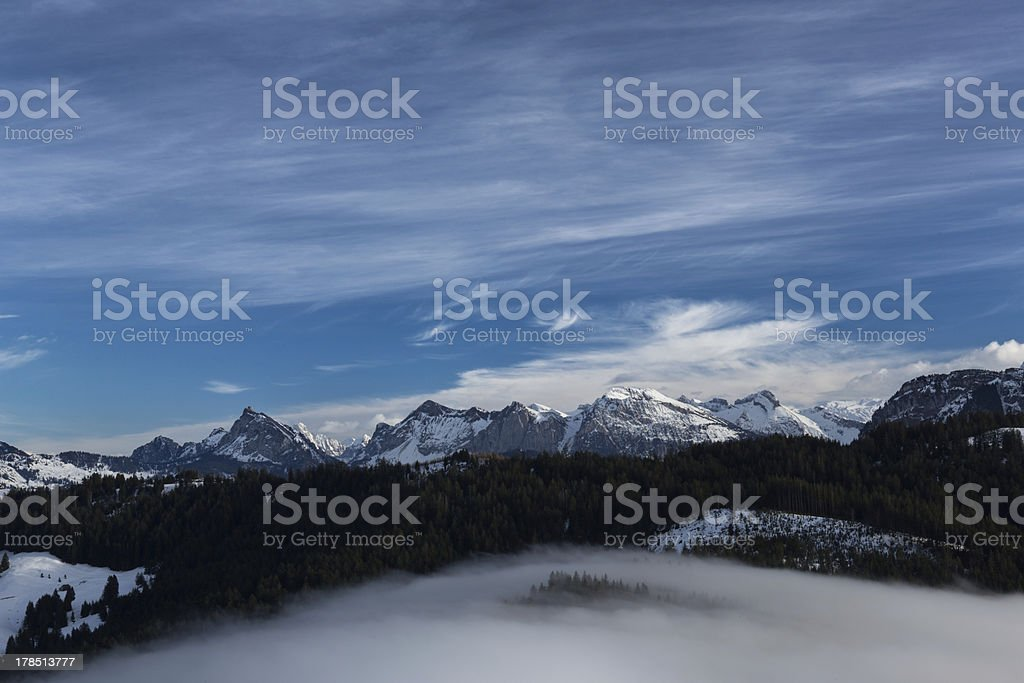 Fog creeps over a ridge stock photo