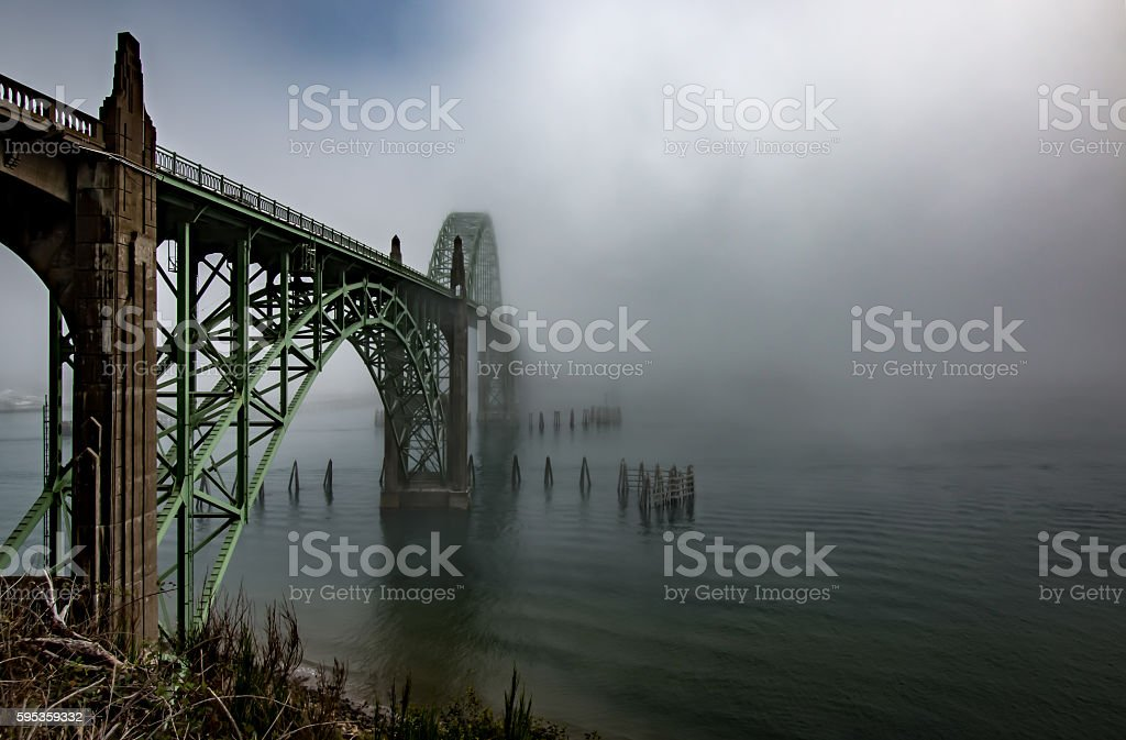 Fog Mist Covering Historic Yaquina Bay Bridge Newport Oregon Coast stock photo