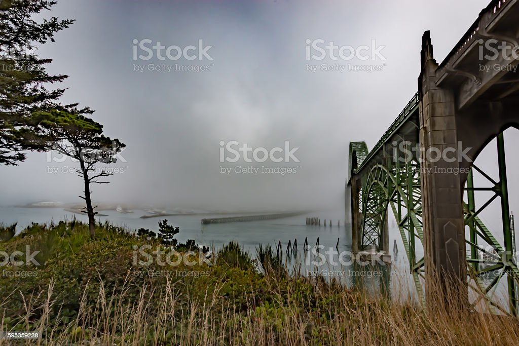 Fog Mist Engulfs Yaquina Bay Bridge Newport Oregon Coast River stock photo