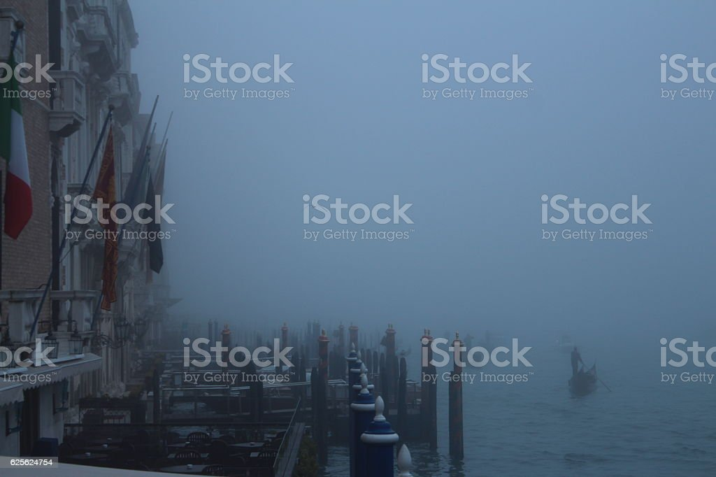 Fog on the canal in Venice stock photo