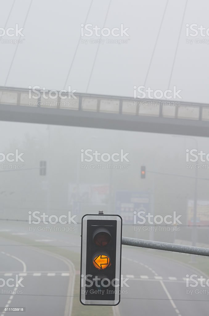 Fog on the road and trafic lights stock photo