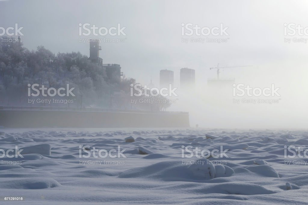 Fog over Amur embankment. Khabarovsk, far East, Russia. stock photo