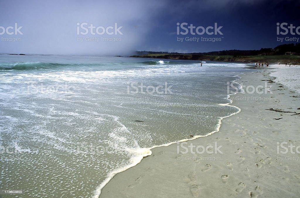 Fog over footprints on the beach stock photo