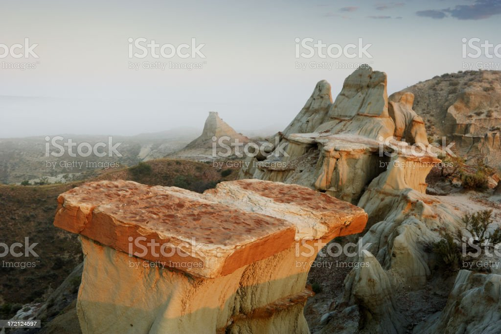 Fog over the Badlands stock photo