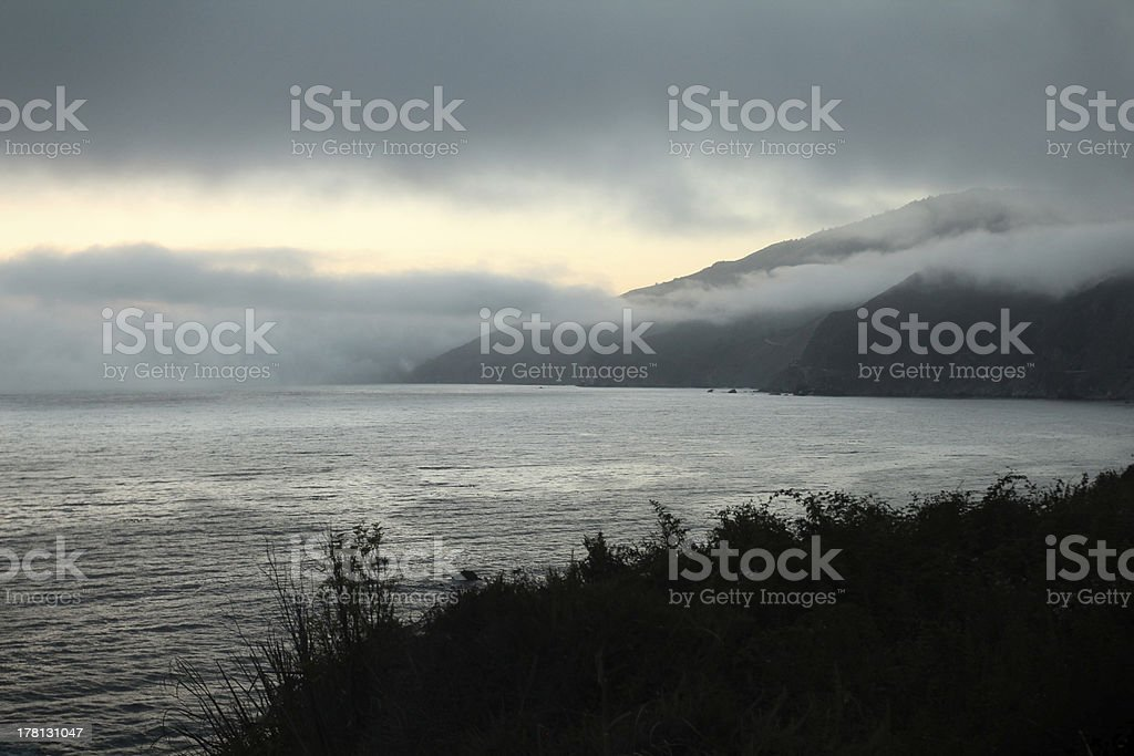 Fog over the ocean at dusk royalty-free stock photo