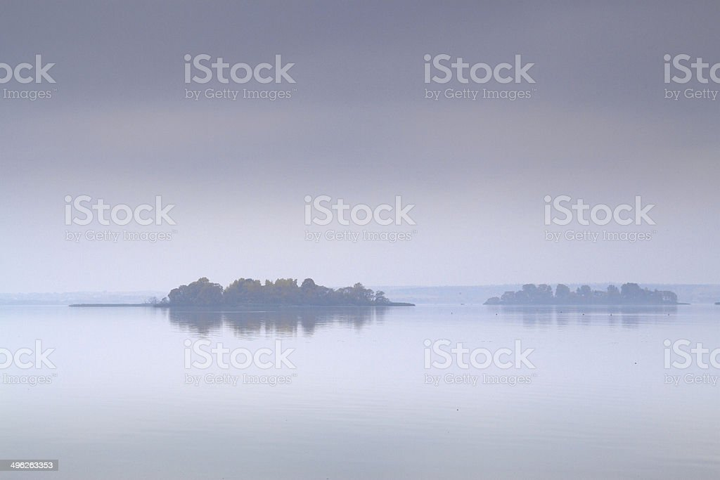 fog over the sea and the island royalty-free stock photo