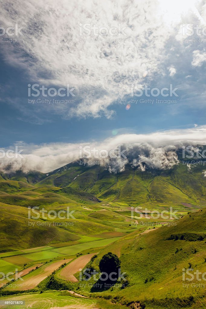 Fog roll over the mountain, Monte Vettore, Castelluccio,  Sibillini , Italy stock photo