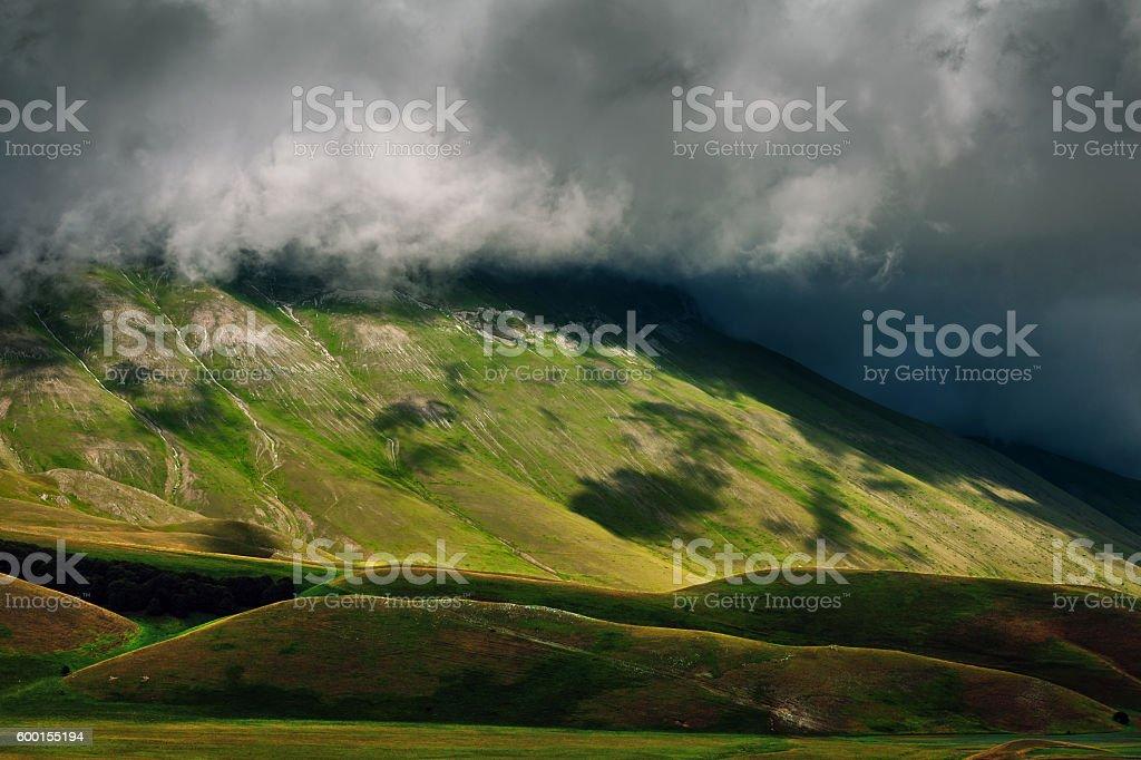 Fog roll over the mountain, Monte Vettore, Castelluccio,  Sibillini , Italy stock photo