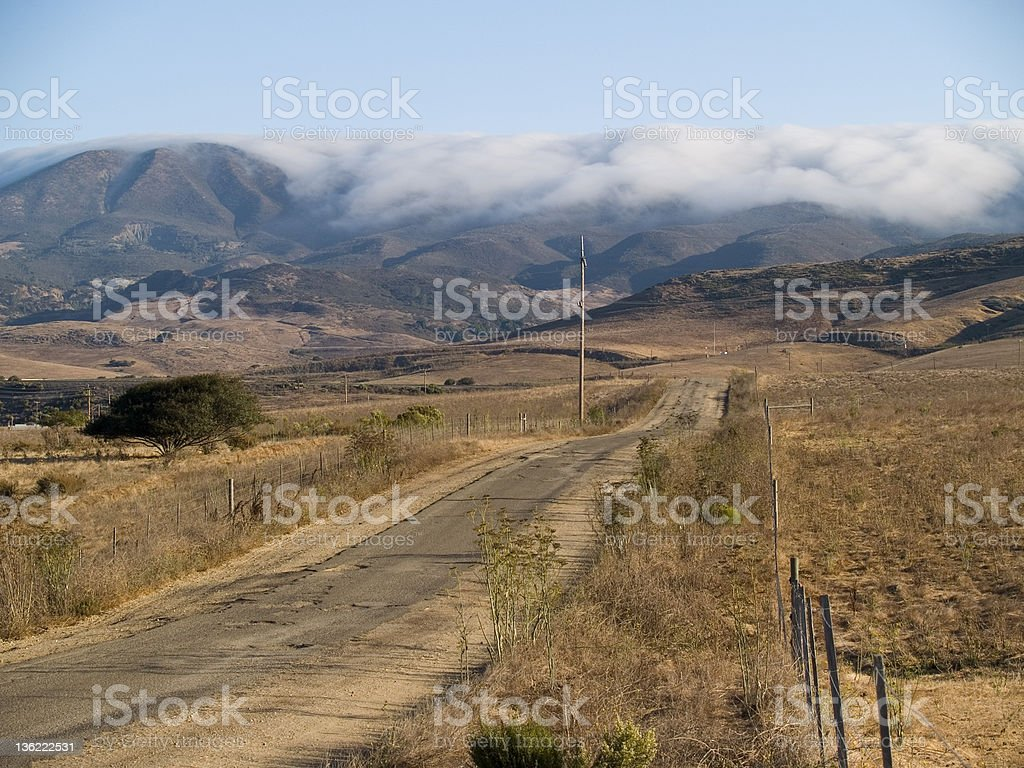 Fog rolling down Cuesta Grade stock photo