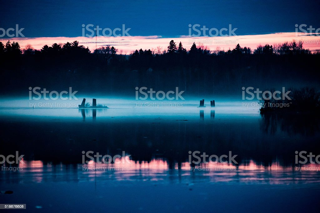 Fog Rolling on the river at sunset royalty-free stock photo