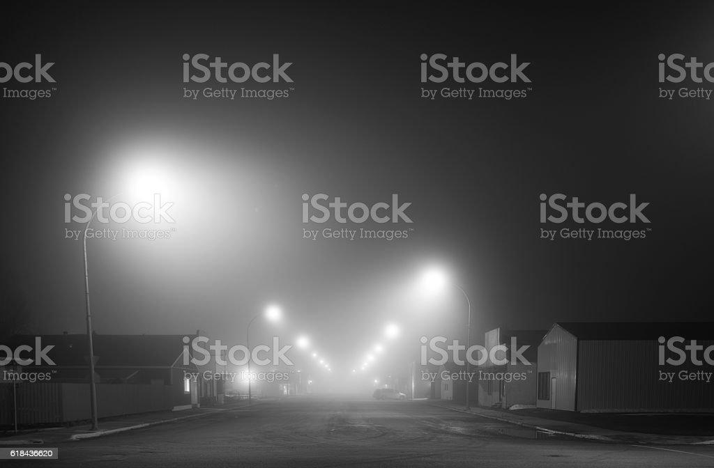 Fog shrouded street stock photo