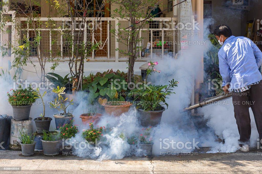 Fogging DDT spray kill mosquito stock photo