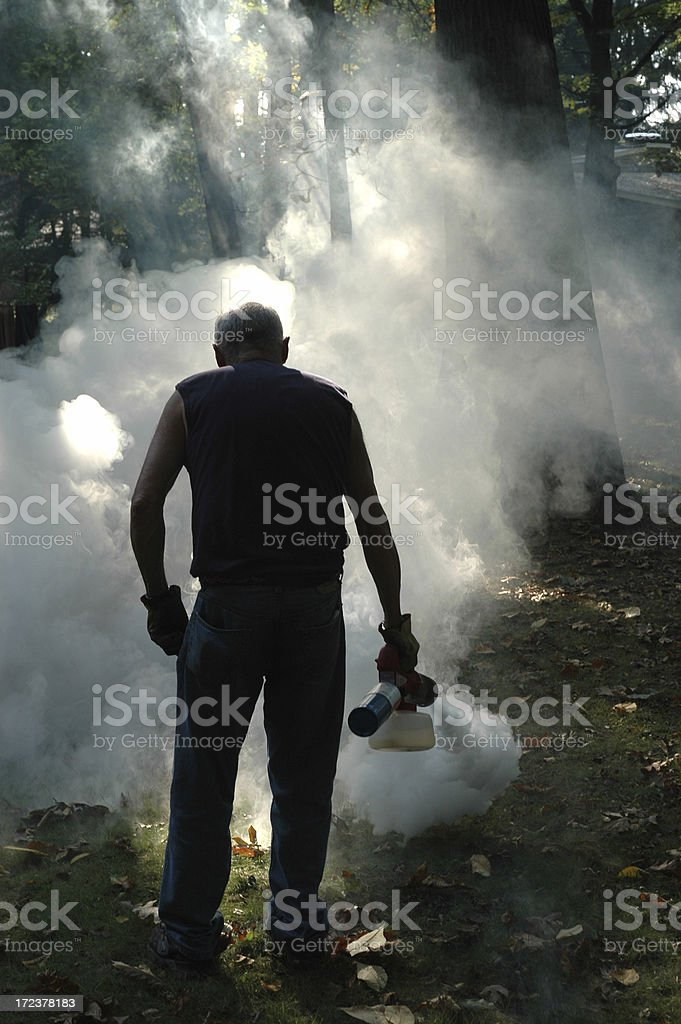 Fogging Mosquitoes royalty-free stock photo