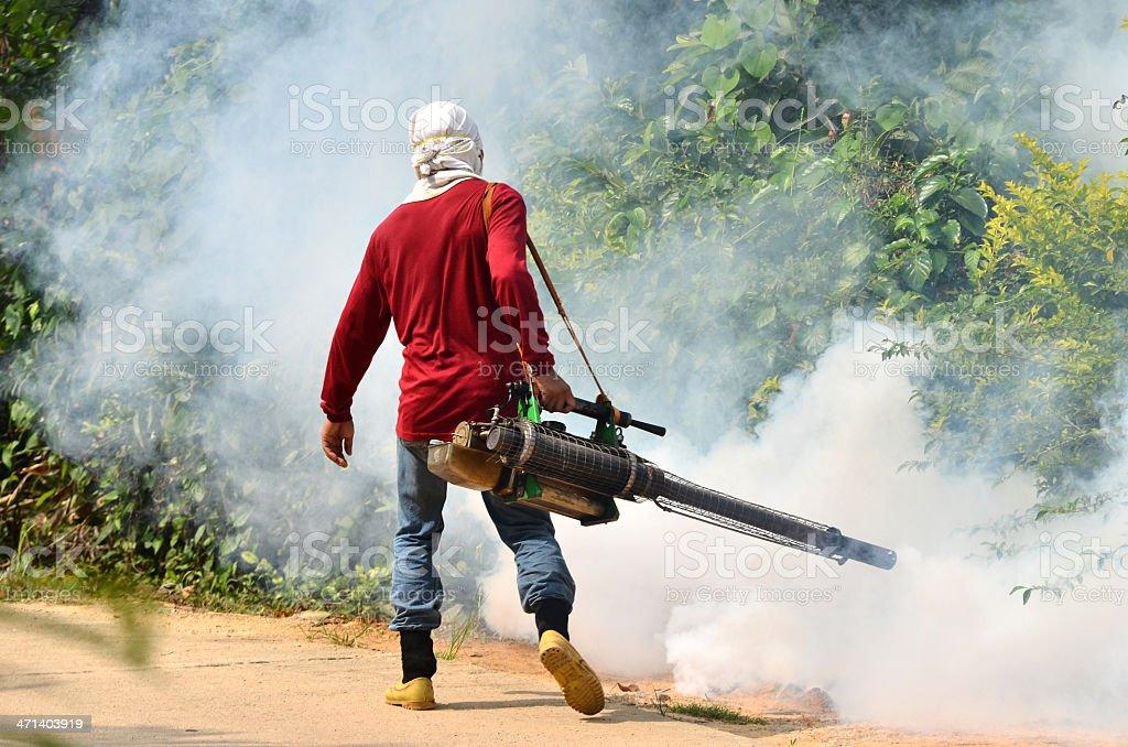 Fogging to prevent spread of dengue fever stock photo