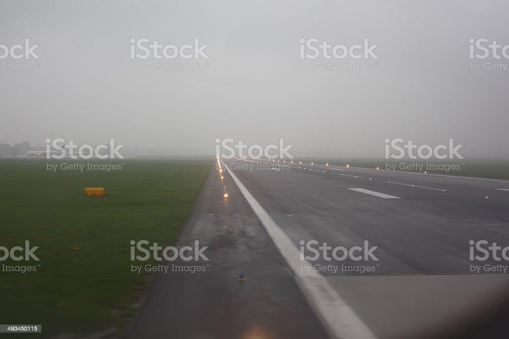 Foggy airport runway stock photo