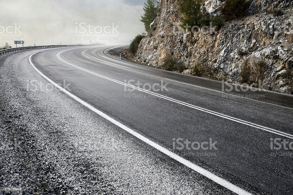 Foggy asphalt road royalty-free stock photo
