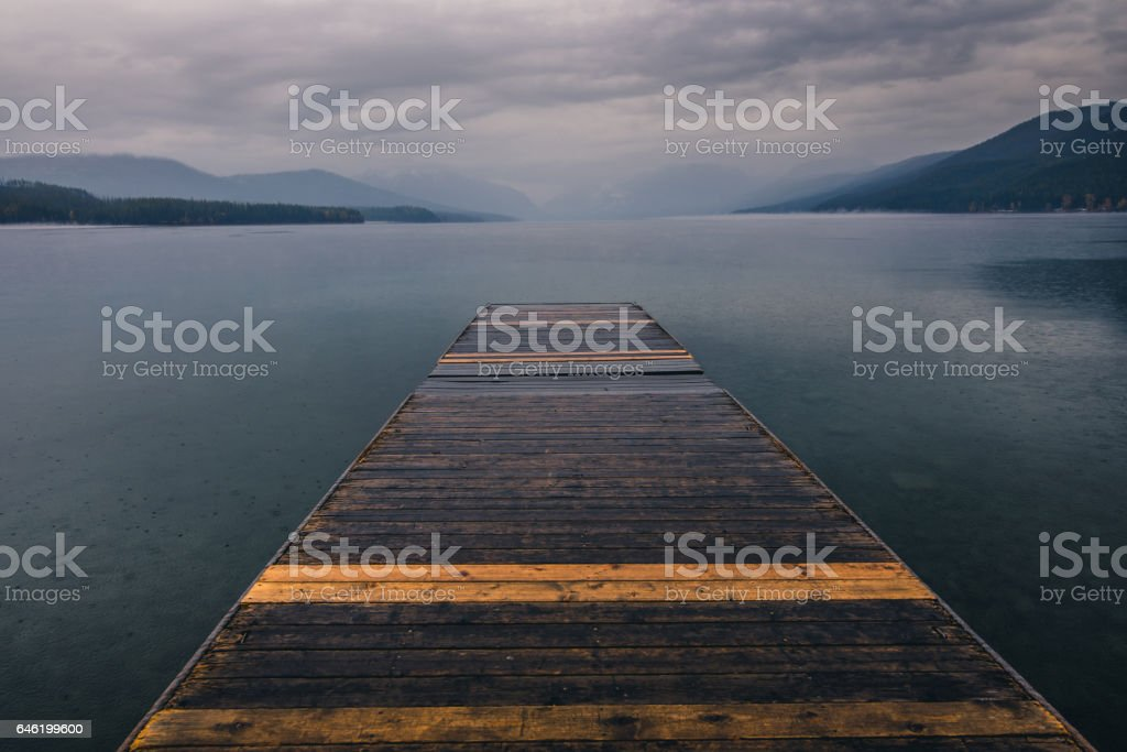 A foggy autumn morning by the lake. stock photo