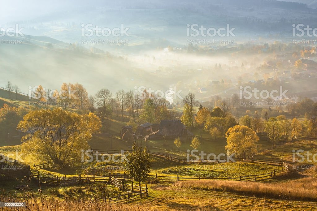 foggy autumn morning in a mountain village stock photo