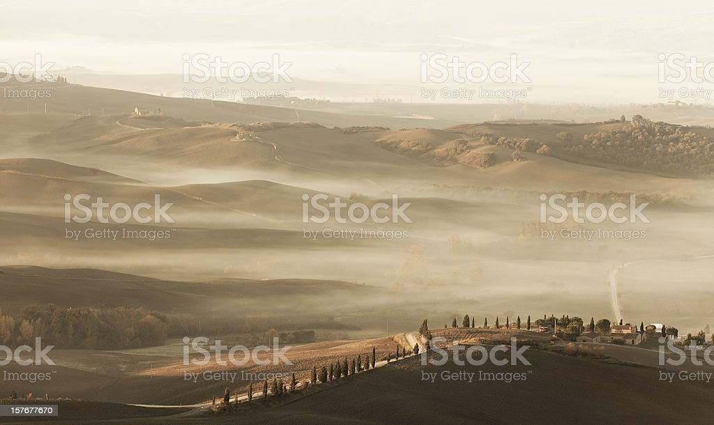 Foggy autumn sunrise in Tuscany royalty-free stock photo