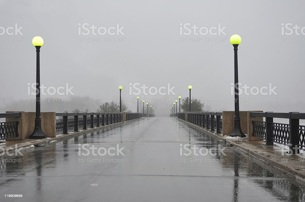 Foggy bridge with other side not visible stock photo