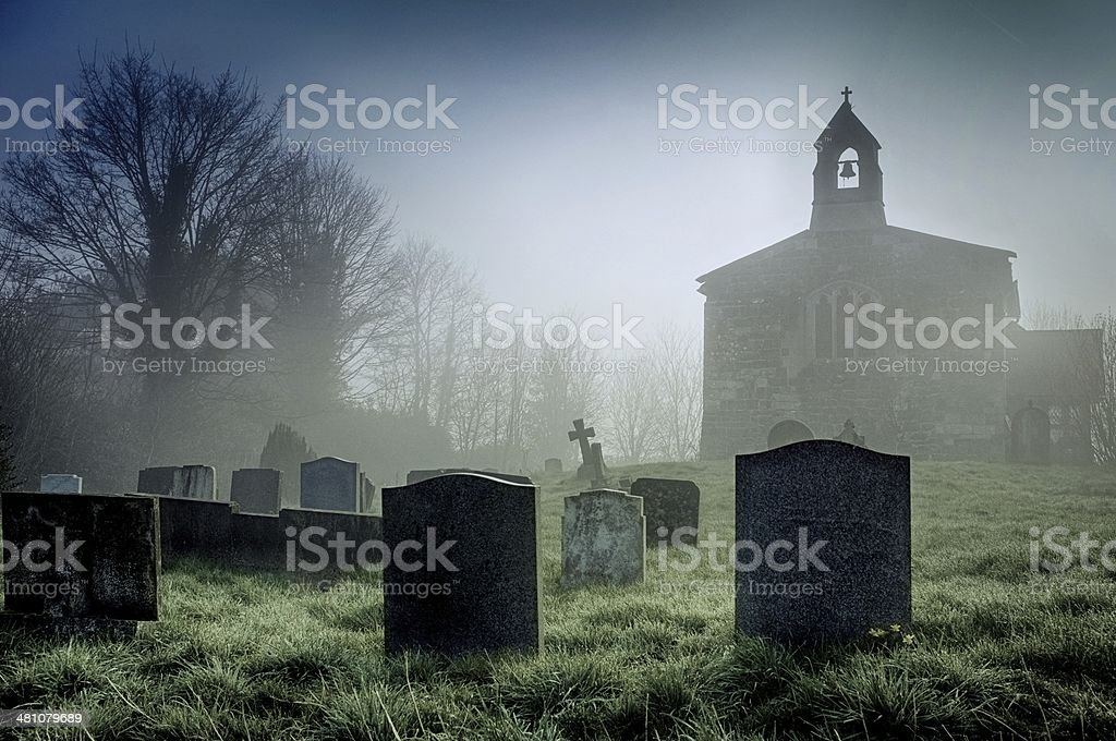 Foggy churchyard on the Lincolnshire Wolds stock photo