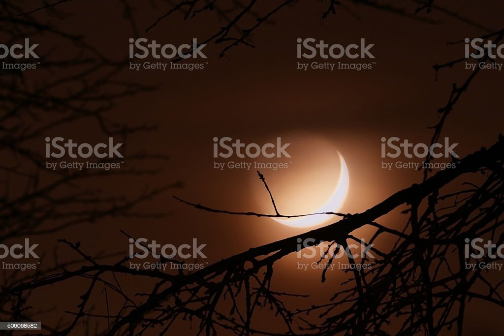 Foggy crescent moon stock photo