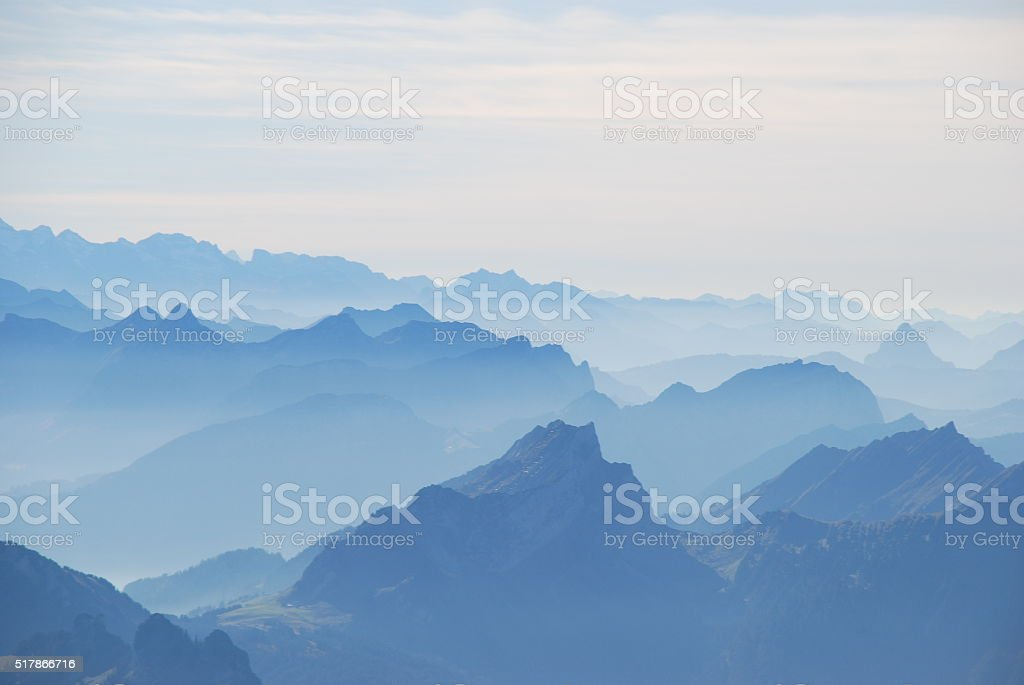 Foggy day in swiss alps stock photo