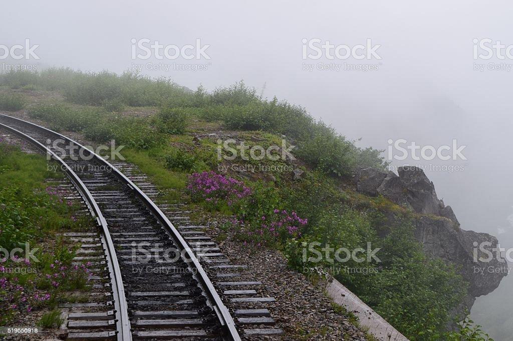 Foggy drop off with train tracks stock photo