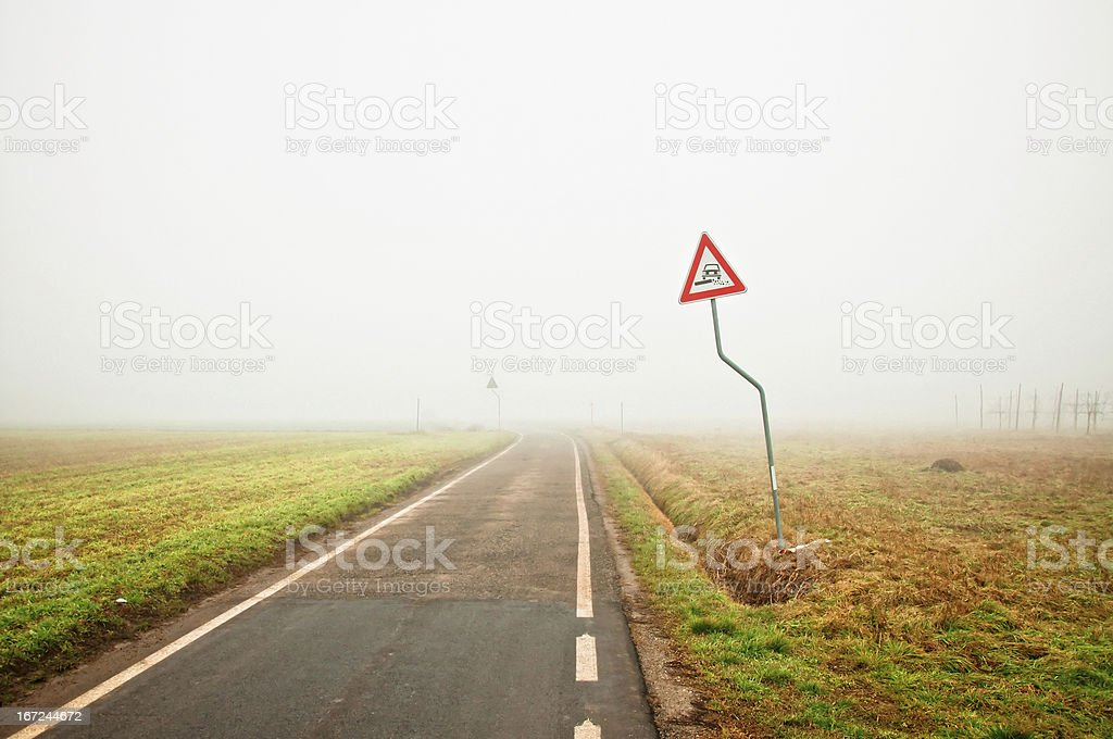 Foggy empty rural road royalty-free stock photo